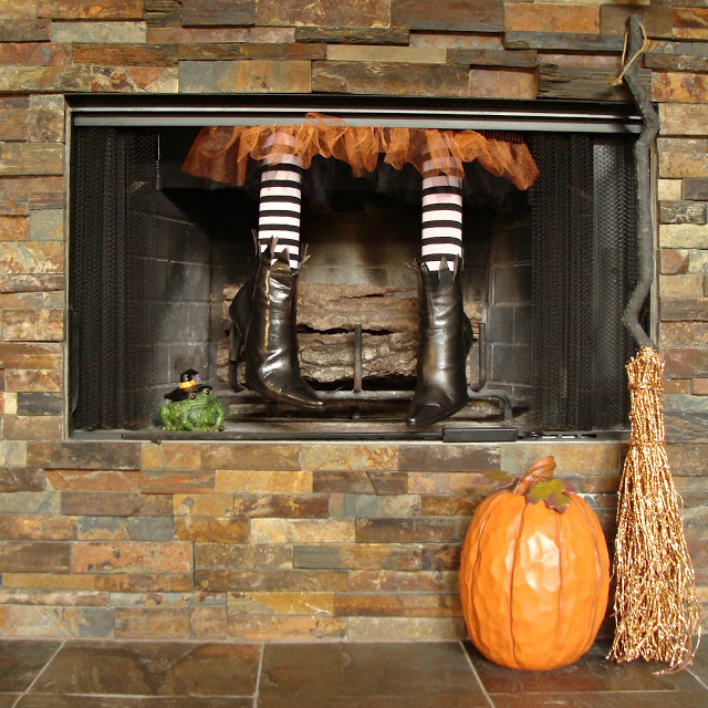 A pair of which legs dangling down the chimney