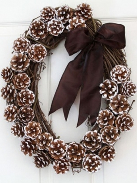 Painted pinecones hot glued onto a wreath.