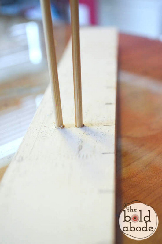 DIY ribbon making tool using a board and dowels - gift wrapping guide