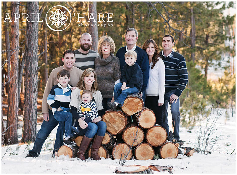 Winter Family Photo Near Wood Logs